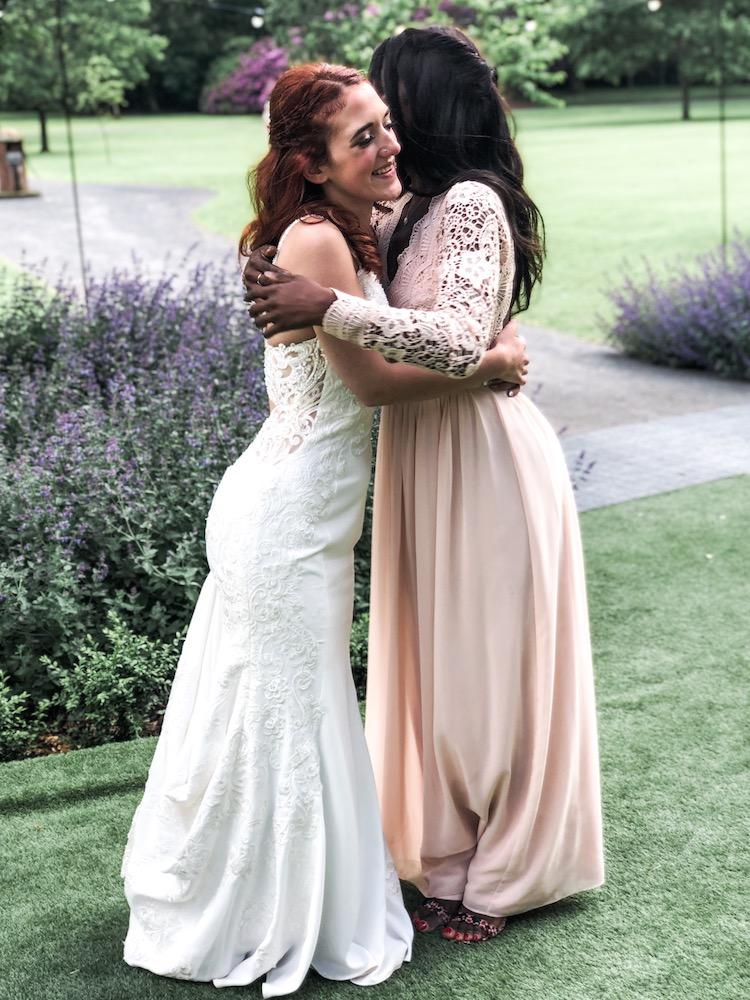 Best friend getting married, hugging the bride