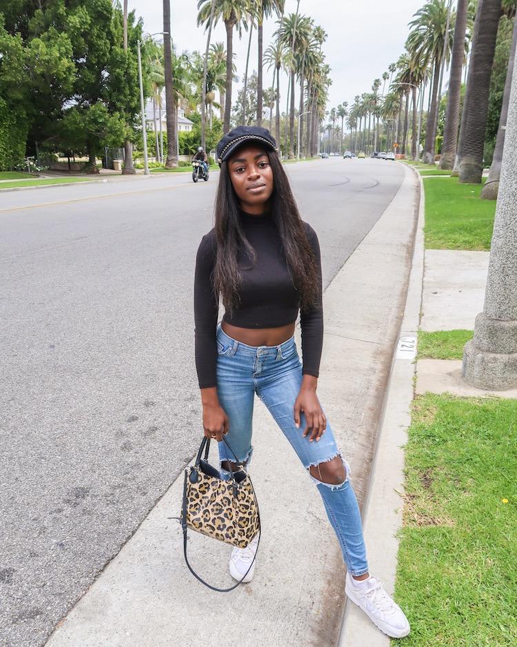 Beverly Hills holding handbag